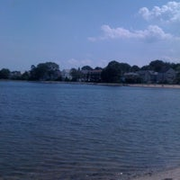 Photo taken at Collins Cove Beach by Carolina B. on 8/18/2011