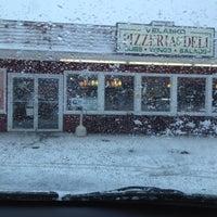 Photo taken at Velasko Pizzeria & Deli by Cabrina G. on 2/12/2012
