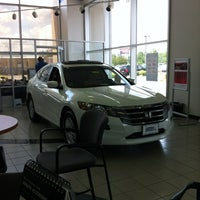 Photo taken at Carey Paul Honda by Cheryl M. on 5/2/2012