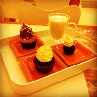 Photo taken at Sweet Surrender Cupcake & Cookie Cafe by John D. on 1/29/2012