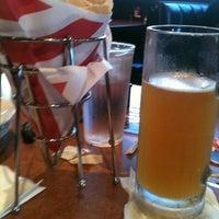 Photo taken at TGI Fridays by Kim S. on 9/1/2012