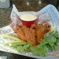 Photo taken at Red Robin Gourmet Burgers by Sotonye S. on 10/23/2011