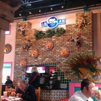 Photo taken at Rosa's Cafe Tortilla Factory by Larry P. on 11/29/2011