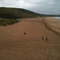 Photo taken at Woolacombe Beach by Richard M. on 7/15/2011