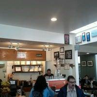 Photo taken at Caffe Strada by Erik P. on 2/5/2012