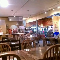 Photo taken at Solstice Wood Fire Cafe by Bryan C. on 10/15/2011