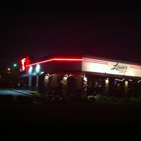 Photo taken at Louie's Grill & Bar by Tony on 7/6/2012