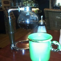 Photo taken at Jaho Coffee Roasters by Steve Q. on 10/15/2011