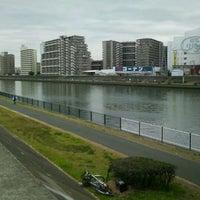 Photo taken at 神崎川河川敷 by Atsushi T. on 1/8/2012