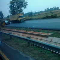 Photo taken at Exit tol curug / bitung by echii r. on 9/6/2011