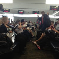 Photo taken at Frontier Airlines (Gates 24 - 32) by Mallory R. on 6/16/2012