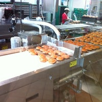 Photo taken at Krispy Kreme Doughnuts by Kevin N. on 12/18/2011