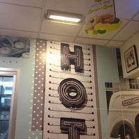 Photo taken at Krispy Kreme Doughnuts by Chris B. on 7/1/2012