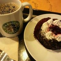 Photo taken at Starbucks Coffee 神田駅前店 by Miho K. on 11/15/2011