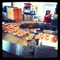 Photo taken at Krispy Kreme Doughnuts by Annee O. on 10/10/2011