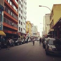Photo taken at Rua Santa Ifigênia by Airton F. on 3/16/2012