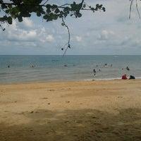 Photo taken at Pantai Teluk Kemang by Azrizah Y. on 7/15/2012