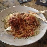 Photo taken at Gratzzi Italian Grille by Allen H. on 3/23/2012
