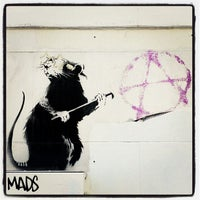 Photo taken at Banksy Mural: 'Glitter Glasses' Rat by David L. on 5/5/2012