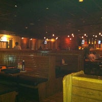 Photo taken at Outback Steakhouse by Tina T. on 9/23/2011