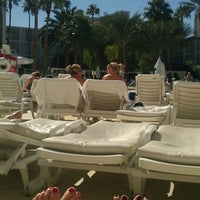 Photo taken at Nikki Beach by Emily P. on 10/29/2011