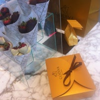 Photo taken at Godiva Chocolatier by Richard B. on 8/14/2012