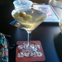Photo taken at Mort's Martini and Cigar Bar by Gina G. on 10/18/2011