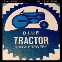 Photo taken at Blue Tractor BBQ & Brewery by Christina G. on 6/5/2012