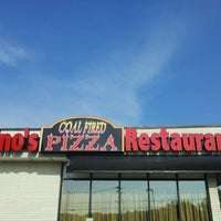 Photo taken at Nino's Coal Fired Pizza by Peter K. on 8/9/2012