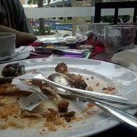Photo taken at Poolside swiss-belhotel by Hadi M. on 6/2/2012
