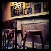 Photo taken at Curbside Cafe by Kari O. on 7/10/2012