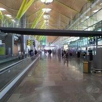 Photo taken at Terminal 4 Satélite by Juan G. on 8/13/2012