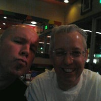 Photo taken at Bongo Johnny's Patio Bar and Grille by John H. on 1/15/2012