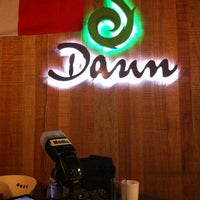 Photo taken at Daun Restaurant by Adam K. on 7/1/2012