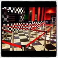 Photo taken at Texas Cinema - Starplex 12 by Caitlyn E. L. on 8/4/2012