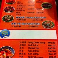 Photo taken at PJ Charcoal Fried Hokkien Mee by Yuri L. on 1/22/2011