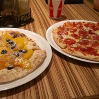 Photo taken at Malawi's Pizza Provo Riverwoods by Sara N. on 9/7/2012