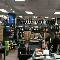 Photo taken at Guitar Center by American Business Language Academy C. on 12/22/2011