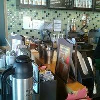 Photo taken at Starbucks by Kelly K. on 9/8/2012