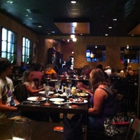 Photo taken at Rioz Brazilian Steakhouse by Kevin Y. on 8/26/2012