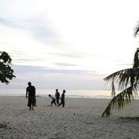 Photo taken at Pantai Saujana (Pantai Batu Empat) by Anna H. on 8/24/2012