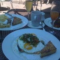 Photo taken at Four Restaurant by Samantha E. on 6/10/2012