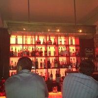 Photo taken at Santos Tapas Bar by Vanessa P. on 8/24/2012