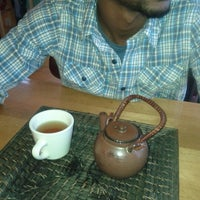 Photo taken at Mandolin Cafe by Celina C. on 6/22/2012