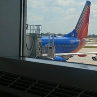 Photo taken at Gate A17 by Sean A. on 6/20/2012