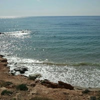 Photo taken at Calas de Rocamar by Maria B. on 6/2/2012