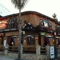 Photo taken at Saddle Ranch Chop House by Mikel A. on 4/6/2012