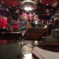 Photo taken at Al Asador Restaurant by Leonardo P. on 8/16/2012