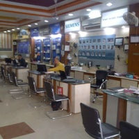 Photo taken at Bhatia Electric Stores Pvt. Ltd. by Saran B. on 2/15/2012