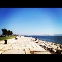 Photo taken at Bostanlı Sahili by Nihan D. on 9/5/2012
